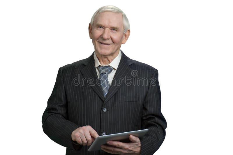Comprimé de tapement supérieur de sourire d'homme d'affaires photos stock