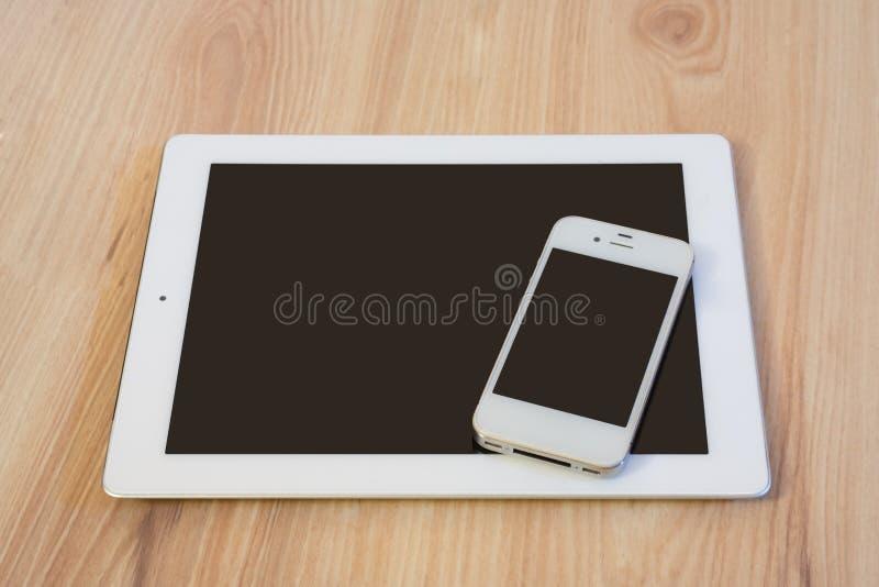 Comprimé et téléphone portable image stock