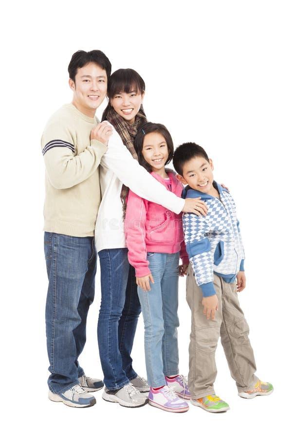 Comprimento completo da família asiática feliz imagem de stock