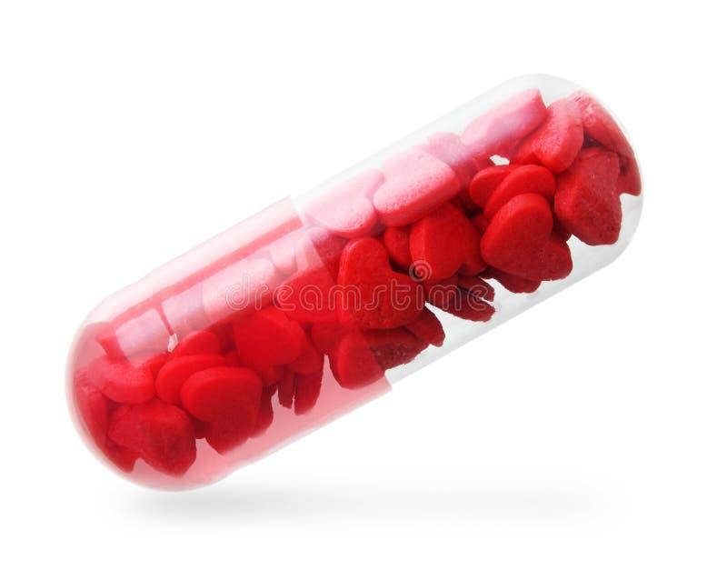 Comprimido com corações vermelhos. foto de stock