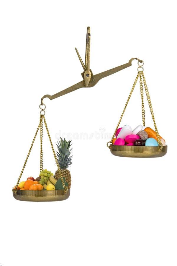 Comprimidos contra a fruta fotos de stock royalty free