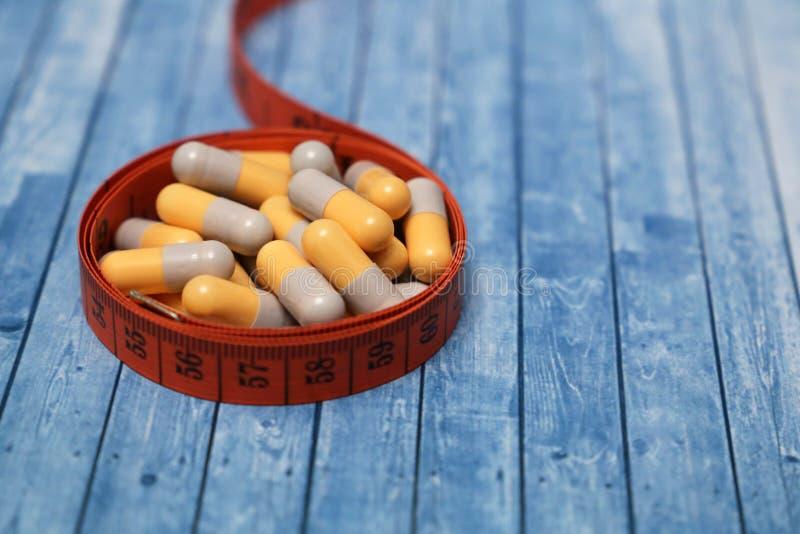 Comprimidos da dieta, remédio da perda de peso foto de stock