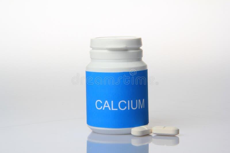 Comprimidos do cálcio fotografia de stock
