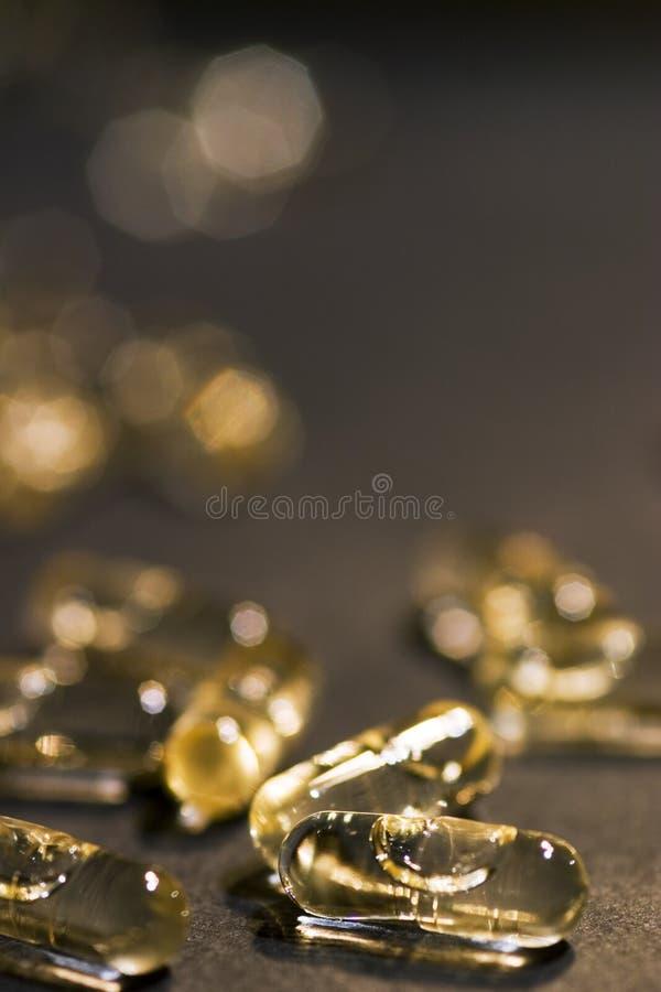 Comprimidos Dourados Imagens de Stock