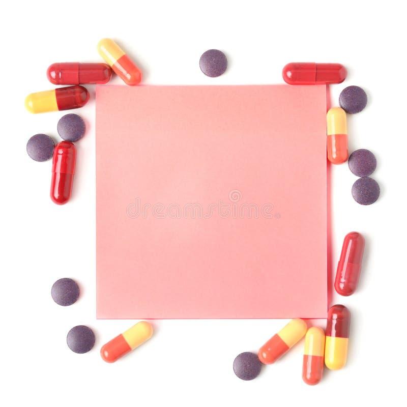 Comprimidos e papel coloridos para notas foto de stock
