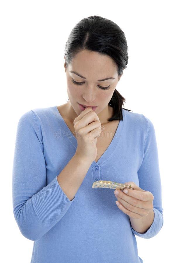 Comprimidos incertos da contracepção fotos de stock