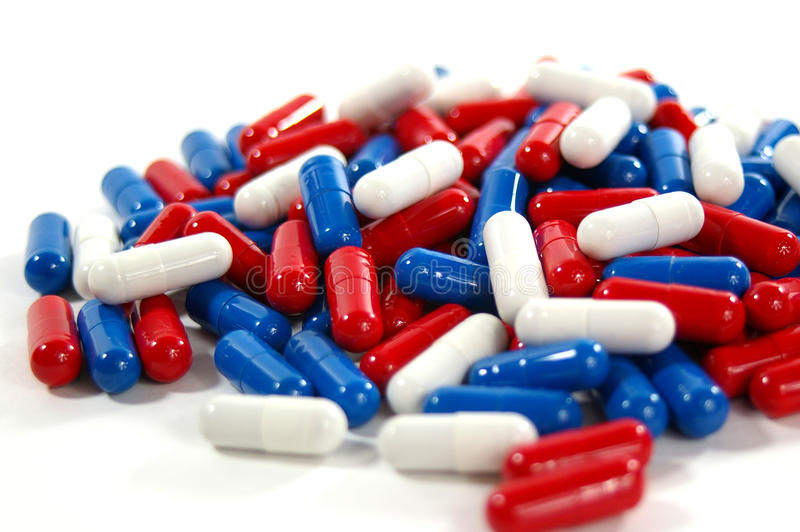 Comprimidos vermelhos, brancos e azuis foto de stock royalty free