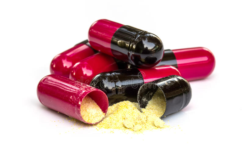 Comprimidos vermelhos e pretos, antibióticos foto de stock