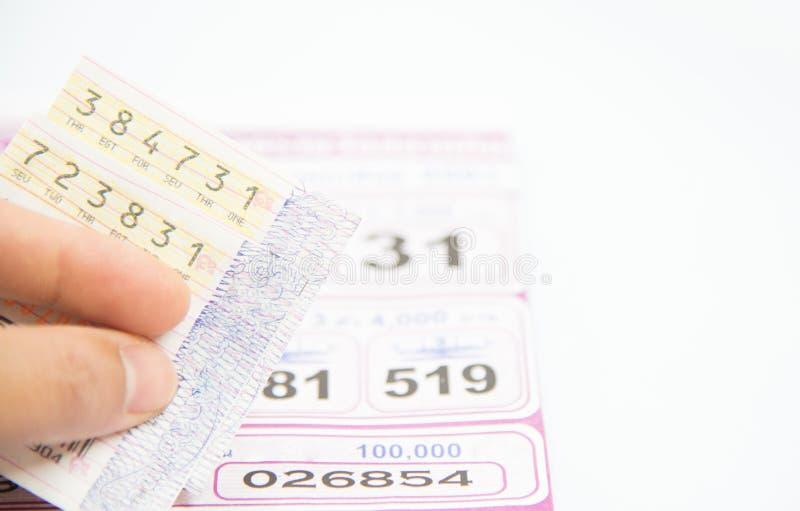 Comprobación de lotería tailandesa en el fondo blanco fotos de archivo