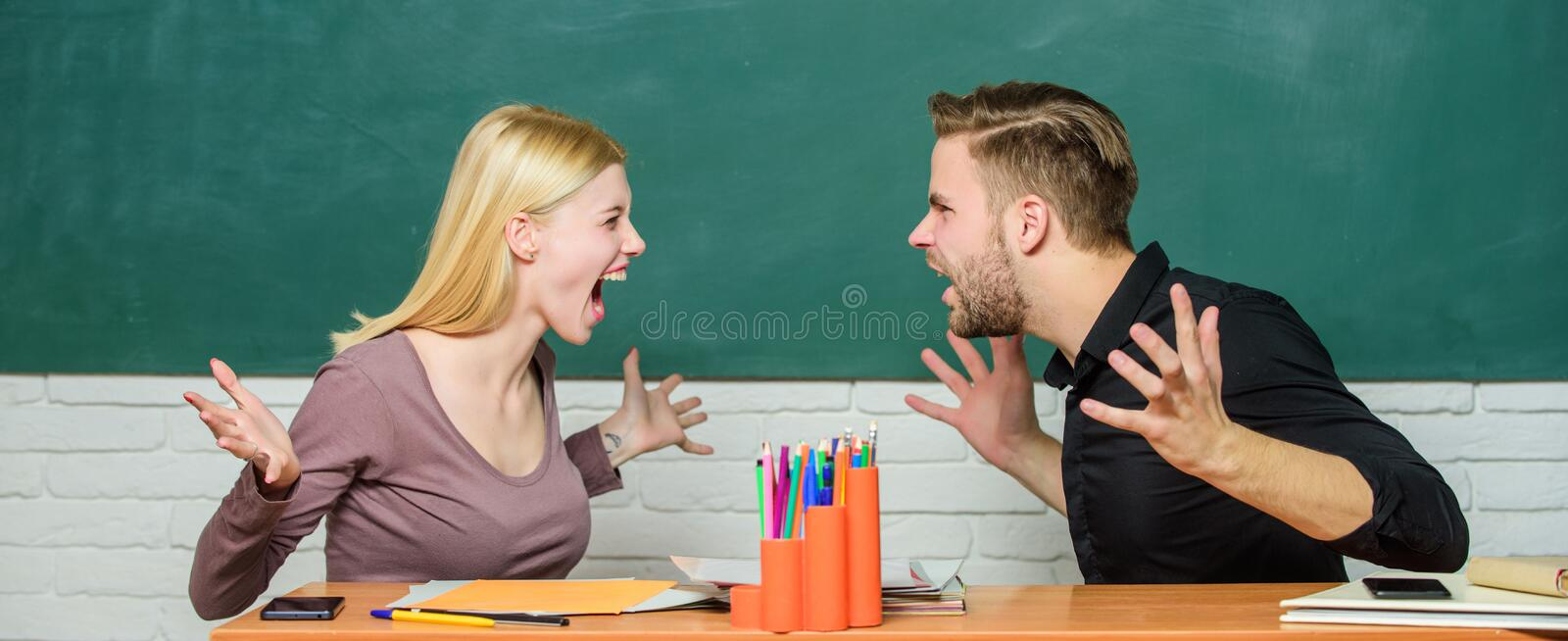 Compromise solution. College relations. Relations classmates. Students communicate classroom chalkboard background. Violence and bullying. Communication stock photo