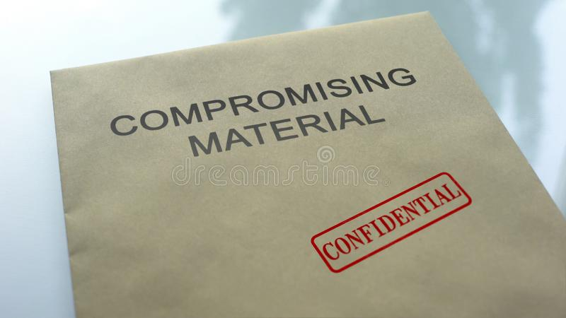 Compromising material confidential, seal stamped on folder with documents stock photos