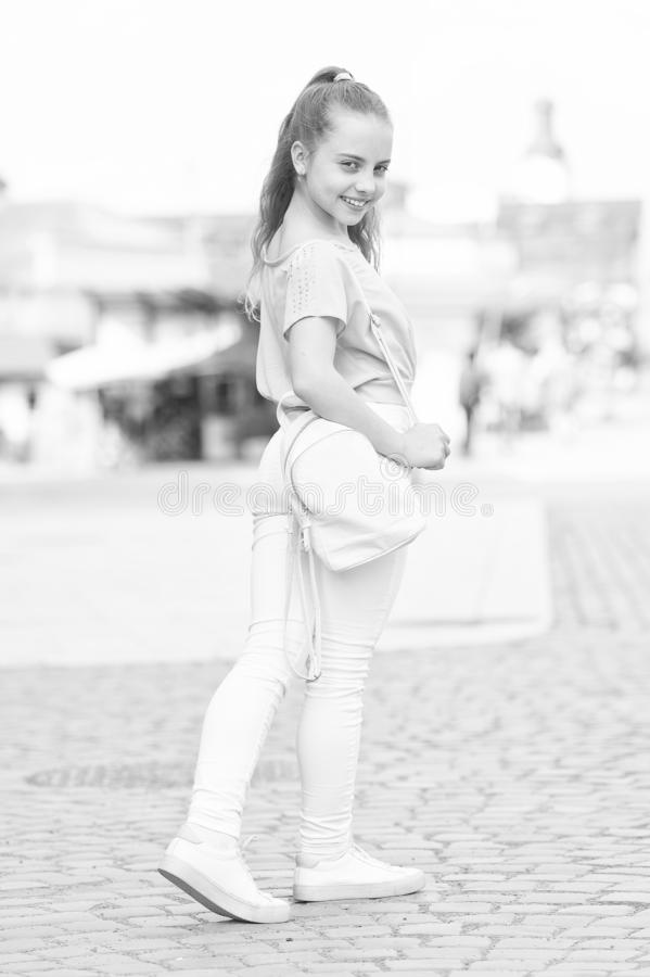 Without compromising on style. Little cute child with beautiful long hair style. Adorable small girl in street fashion. Style on summer day. Her style is royalty free stock photo