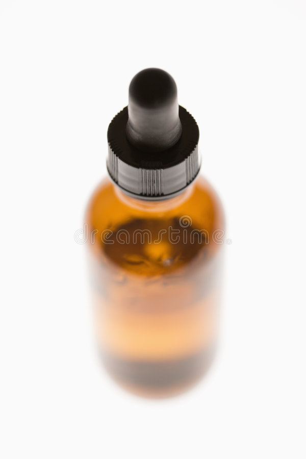 Compte-gouttes et bouteille. photos libres de droits