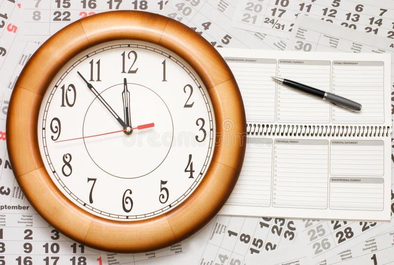 Compuesto del calendario y del reloj fotos de archivo