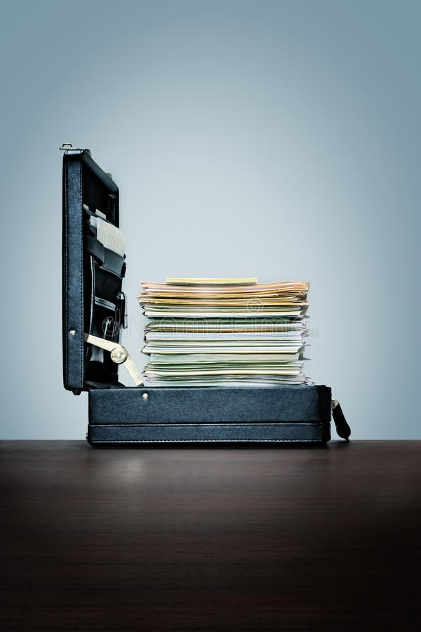 Homework, huge stack of files and folders in briefcase. royalty free stock image