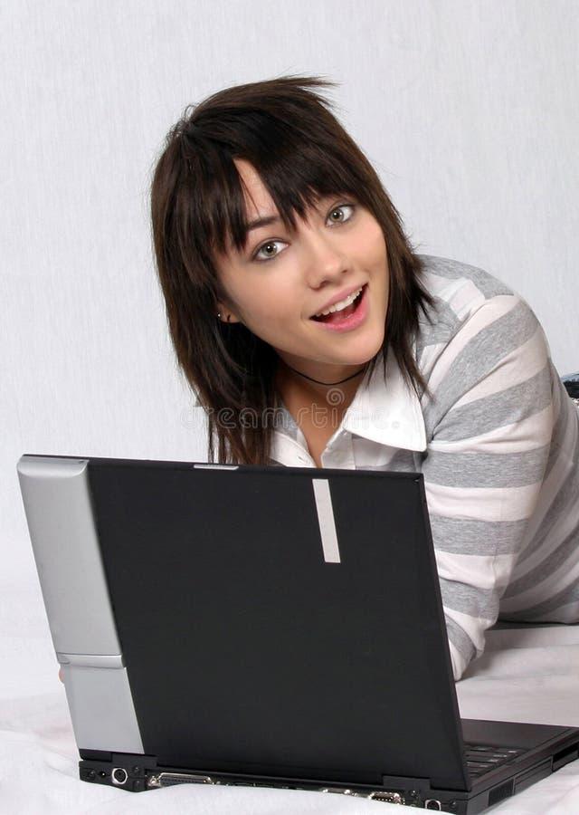 Computador adolescente fotografia de stock