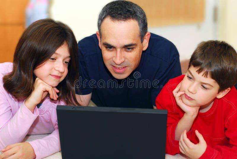Computador da família imagem de stock royalty free