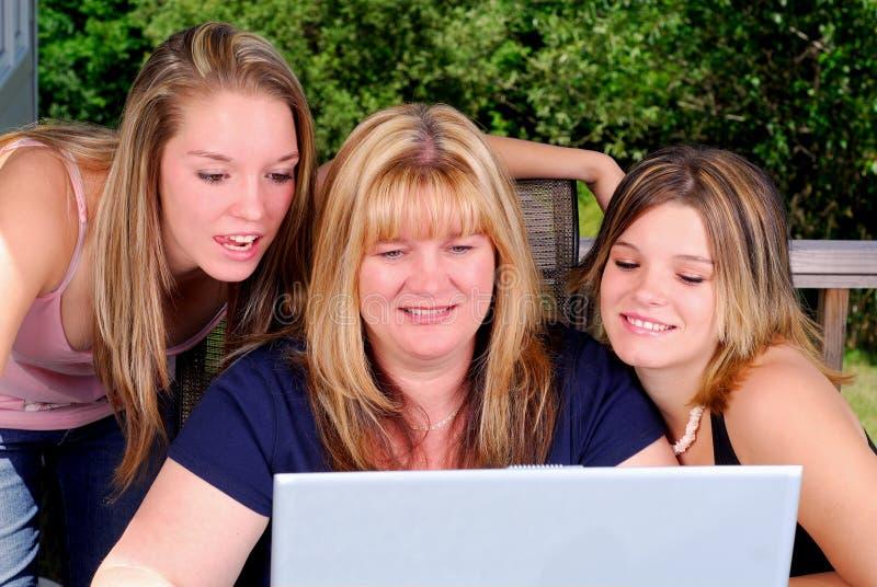 Computador da família foto de stock