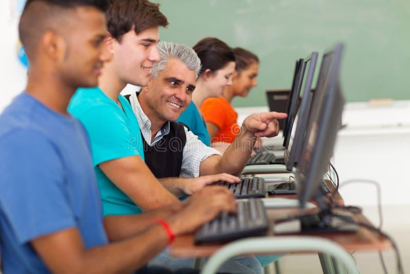 Computador do estudante do professor foto de stock