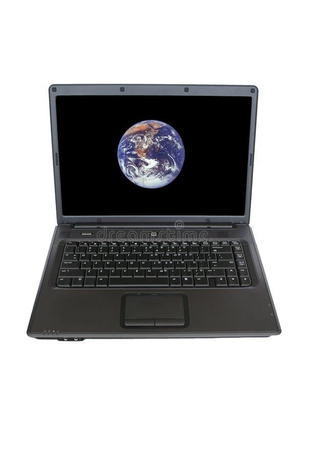 Computador e terra fotografia de stock