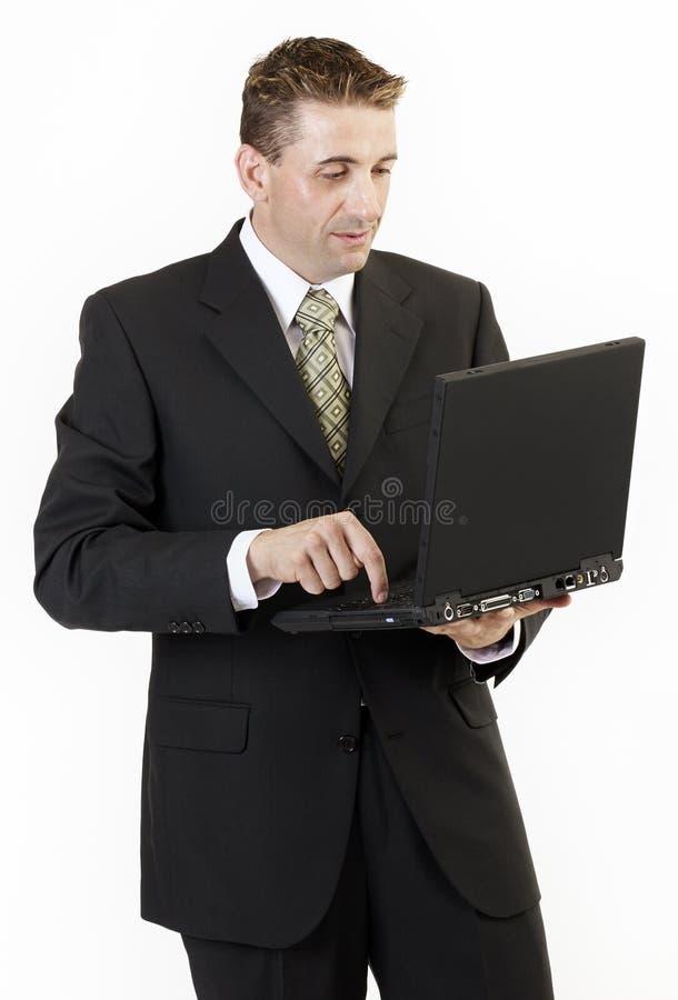 Computadora portátil 2 del hombre de negocios fotos de archivo libres de regalías