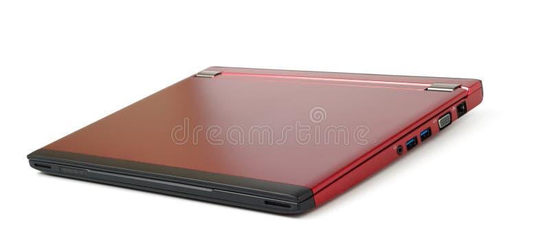 Computadora portátil cerrada roja fotos de archivo