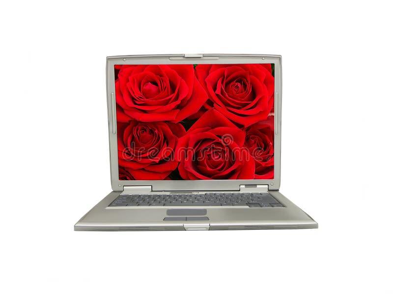 Computadora portátil con la pantalla color de rosa del rojo imagen de archivo