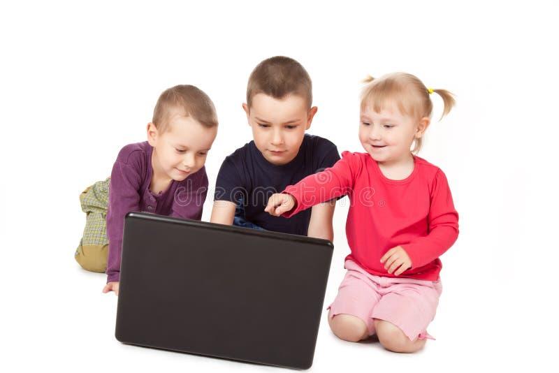 Computadora portátil de la pizca de Childs fotografía de archivo