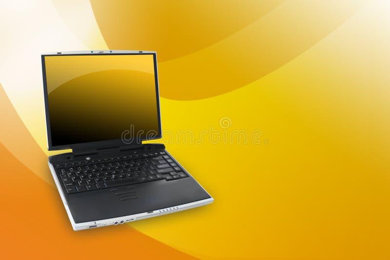 Computadora portátil del amarillo anaranjado foto de archivo libre de regalías
