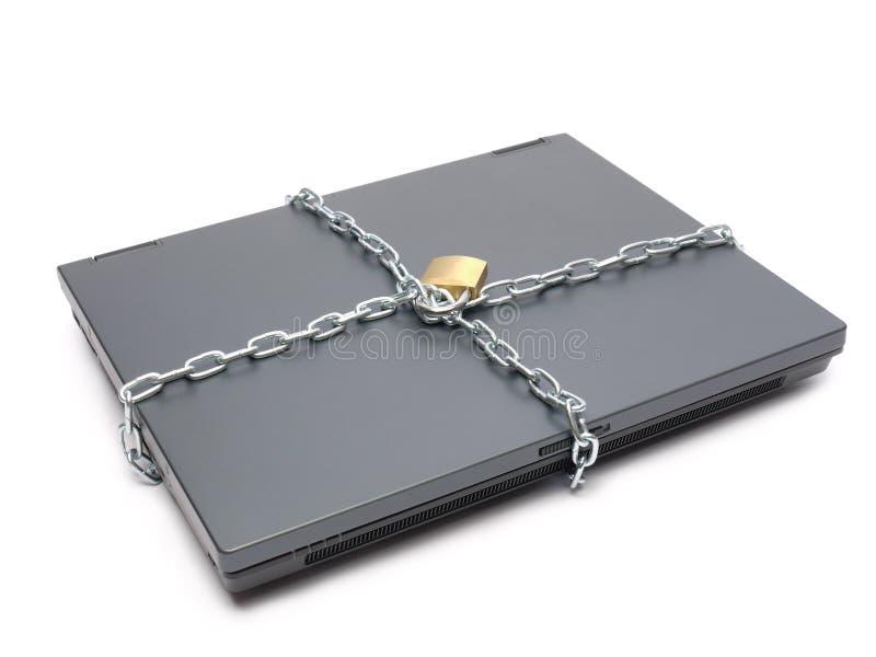 Computadora portátil encadenada imagen de archivo