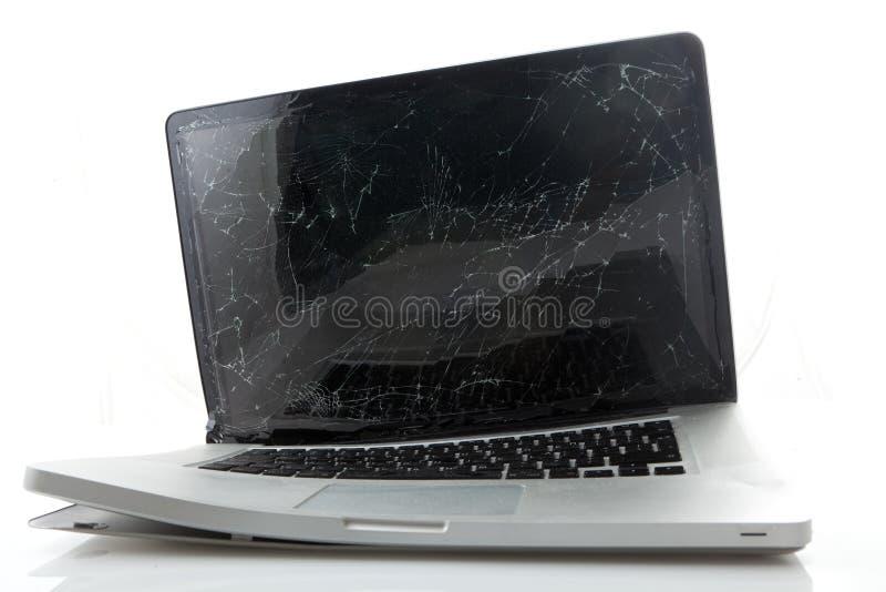 Computadora portátil quebrada fotografía de archivo