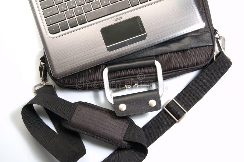 Computadora portátil y bolso imágenes de archivo libres de regalías