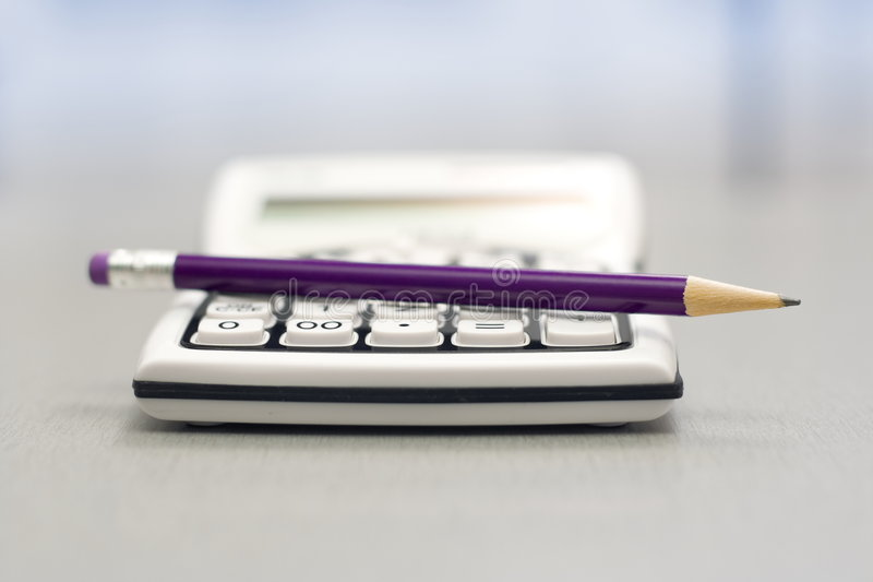 Computational objects. Pocket calculator and graphite pencil stock photo