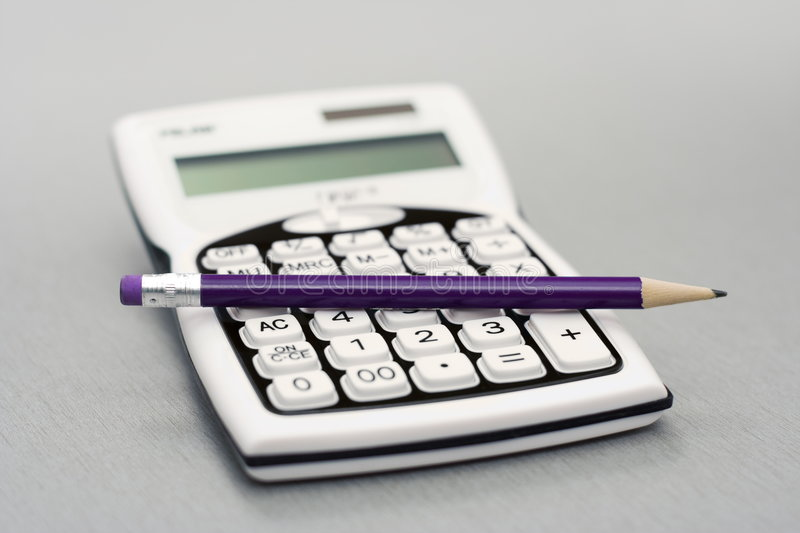 Computational objects. Pocket calculator and graphite pencil stock images