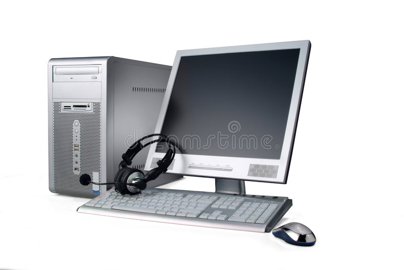 Computer. A silver case computer,with lcd monitor, keyboard, phones and mouse, isolated over white. Has clipping path