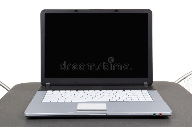 Computer auf grauer Tabelle stockfotos