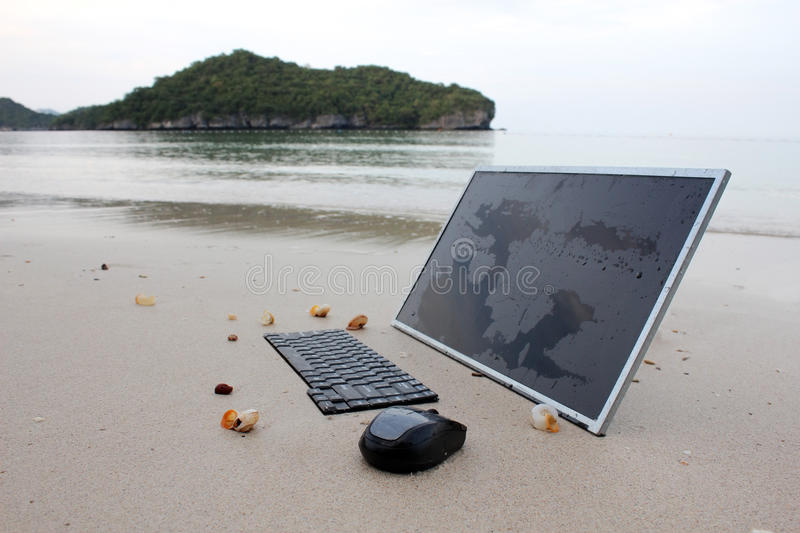 The computer on the beach. stock photo