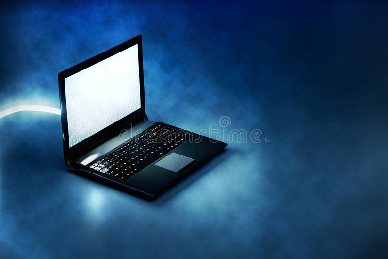Computer on a blue background. A cutting edge computer with binary code on the screen and a high-speed connection is lying on a blue plane and it is surrounded stock photography