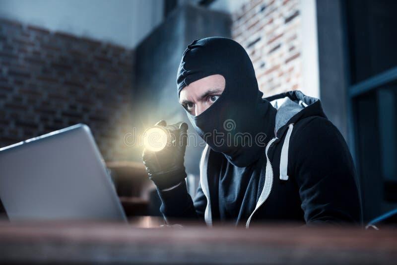 Computer burglar stealing computer data stock photo