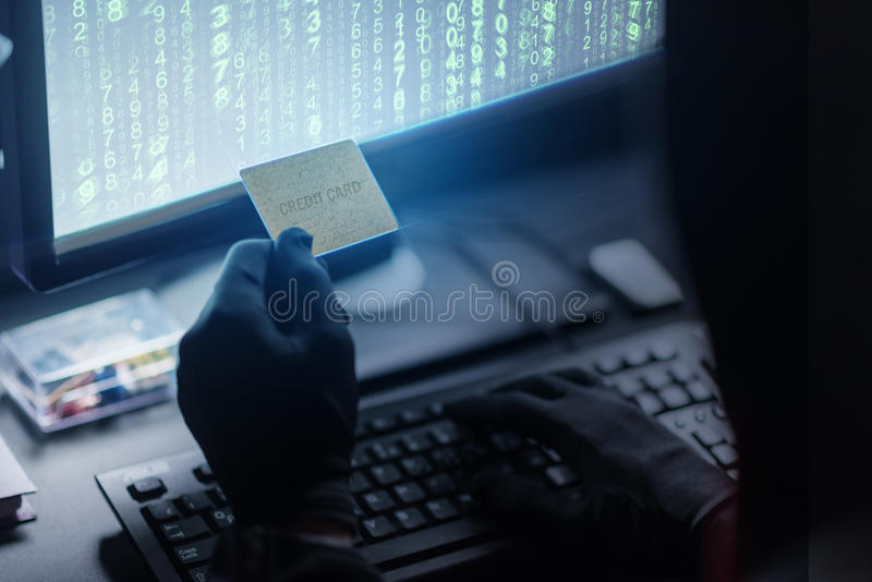 Computer burglar is stealing money stock images