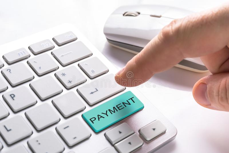 Computer button with payment sign. Finger pressing computer button with payment sign royalty free stock photography