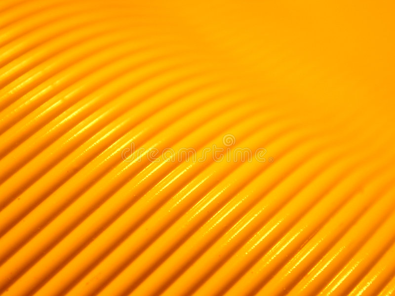 Computer Cable Background 2. A macro shot of yellow computer cord useful as a background or texture. Sorry, raw image is not available for this image royalty free stock images