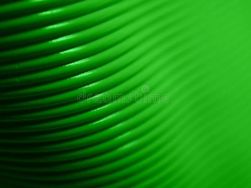 Computer Cable Background 4. An up close macro image of a green computer cord useful as a background or texture stock image