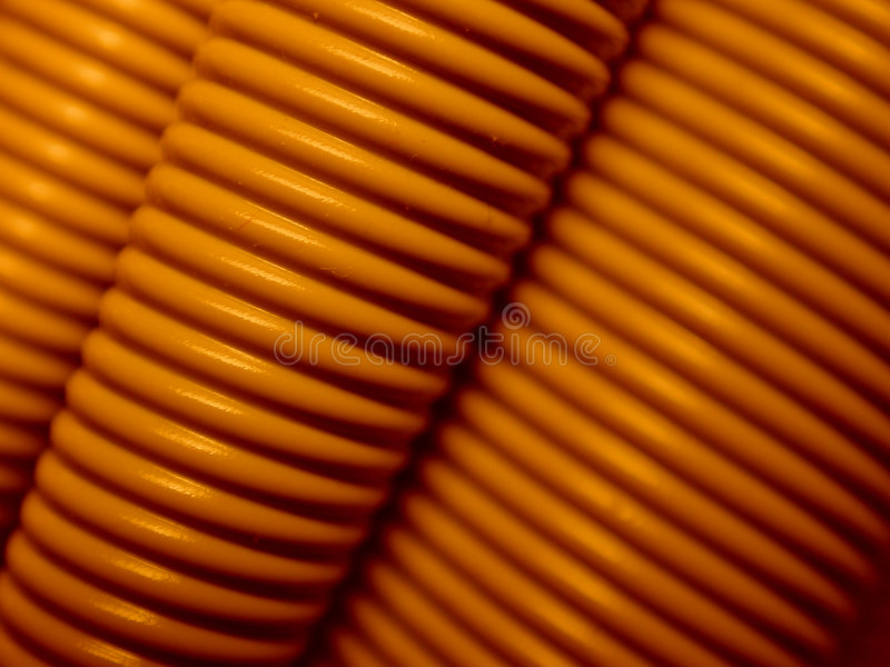 Computer Cable Background 5. A macro of computer cord in brown colors useful as a background or texture stock photography