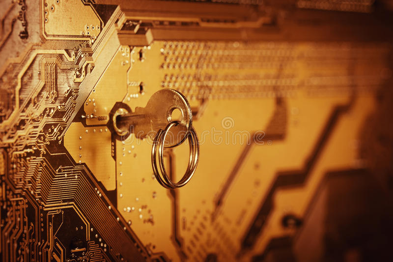 Computer chip with key stock photography