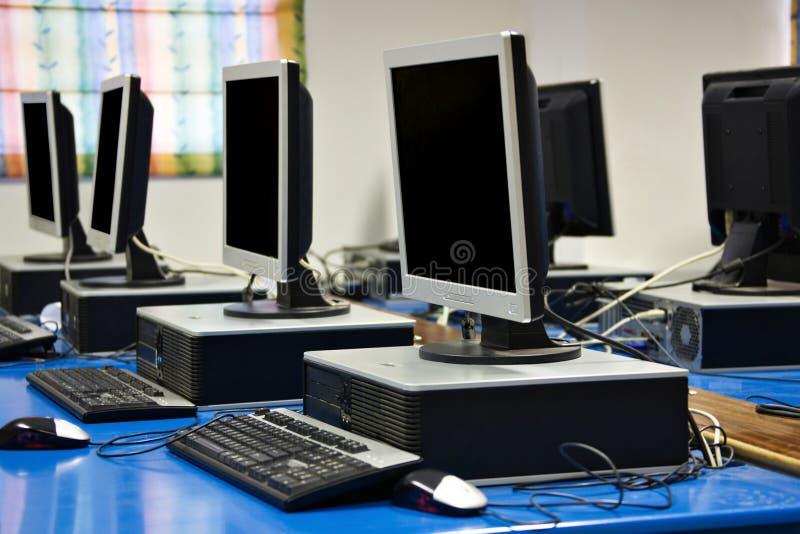 Computer classroom. Row of desktops in a computer classroom stock photo