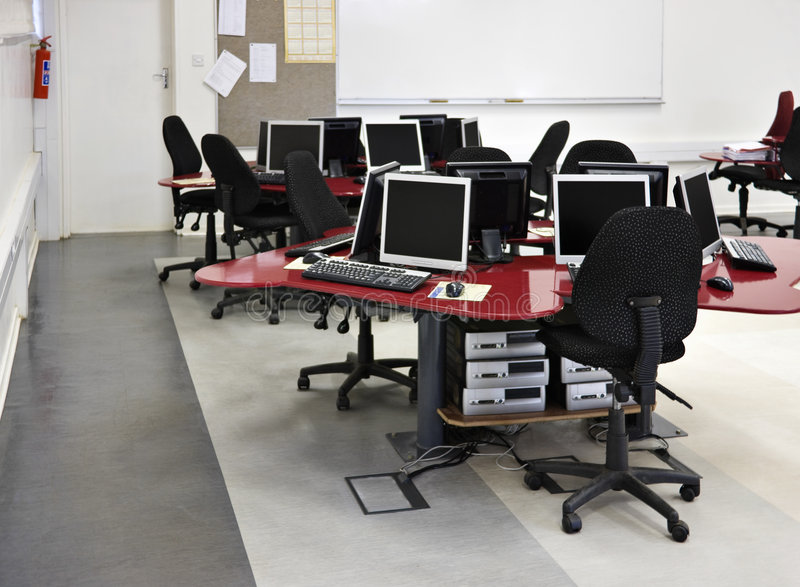 Computer classroom. Networked desktop computers in a college modern laboratory royalty free stock photo