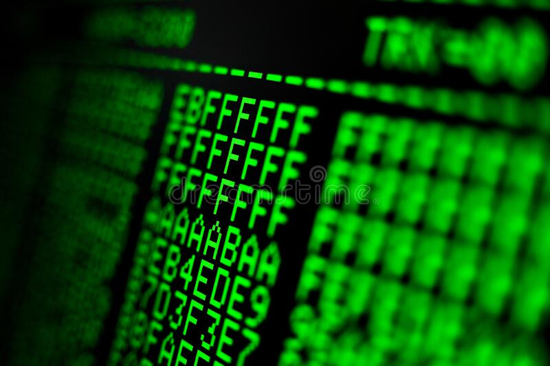 Computer code on the screen. Programming language. Green numbers and letters. Computer science stock photo