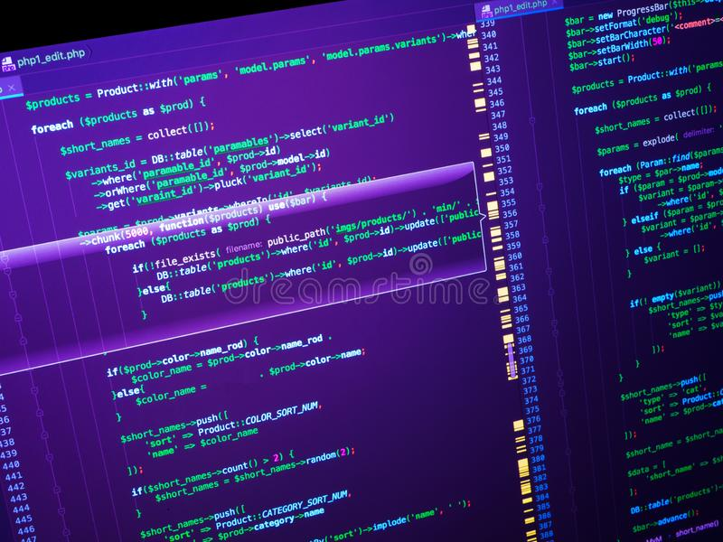 Computer code on the screen (web developing). PHP code on purple background. Web developing of the site using php language. PHP code on purple background royalty free stock photos