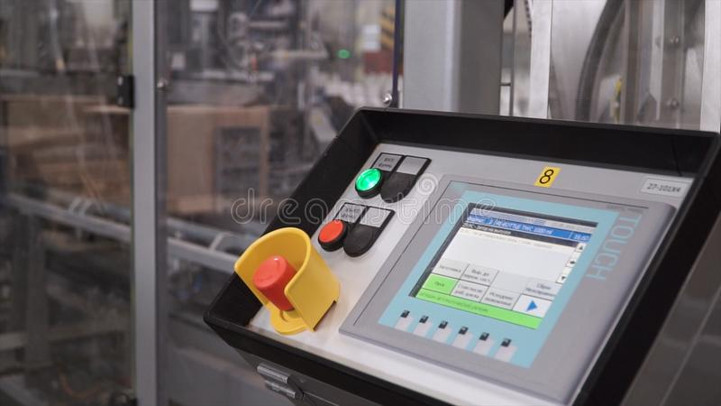 Computer controlled conveyor belt. Clip. Control Panel of industrial CNC machine in factory. Computer equipment at royalty free stock photo